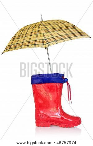 Rain Boot And A Yellow Umbrella