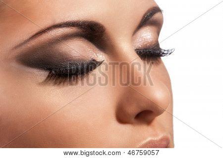Closeup image of beautiful young caucasian  woman with evening makeup