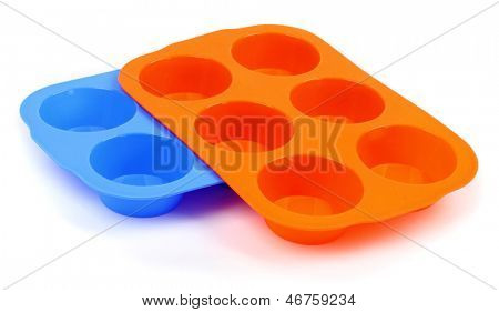 A color silicone muffin molds on a white background