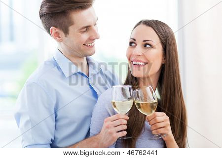 Couple having toast in new home