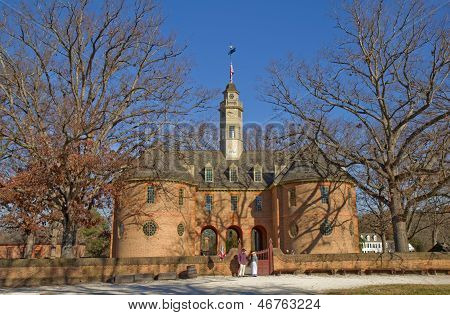The Reconstructed Capitol Building In Colonial Williamsburg, Virginia, Against A Bright Blue Sky