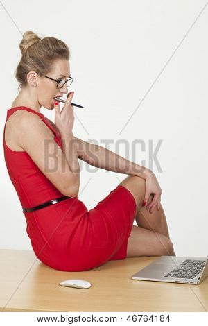 Hot Office Assistant Sitting On Table And Working