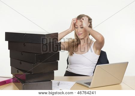 Businesswoman Frustrated With The Bundle Of Files
