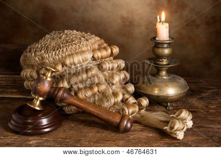 Still life with candle, judge's antique wig and gavel