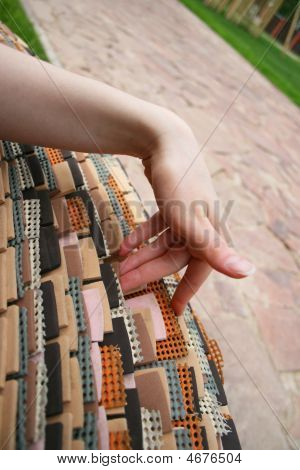 Woman Hand Touching Rubber Bench