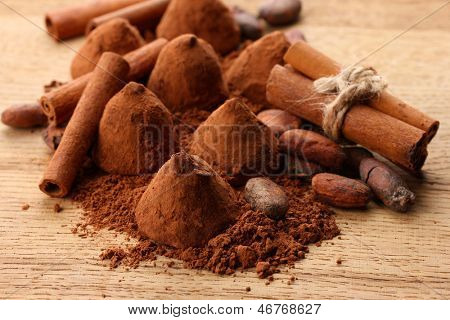Composition of chocolate  truffles, cocoa and spices on wooden background