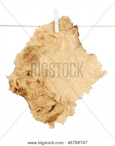 Old sheet of paper hanging on rope isolated on white