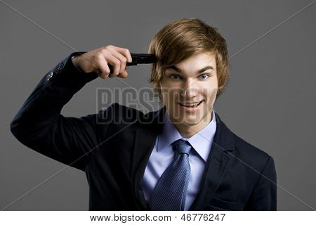 Crazzy businessman giving a gunshot on his own head