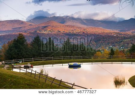 Swimming Pond With Mt. Mansfield In The Autumn.