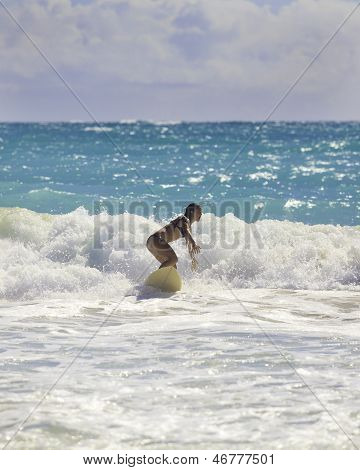 Blond Girl Surfing The Waves