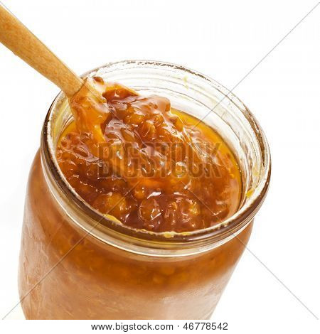 cloudberry jam jar with wooden spoon close up isolated on white background