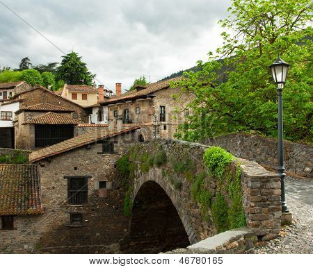 old bridge in Potes. Potes is a municipality in the autonomous community of Cantabria in Spain.