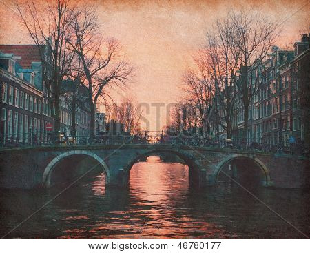 Evening in Amsterdam, Netherlands . Photo in retro style. Paper texture.
