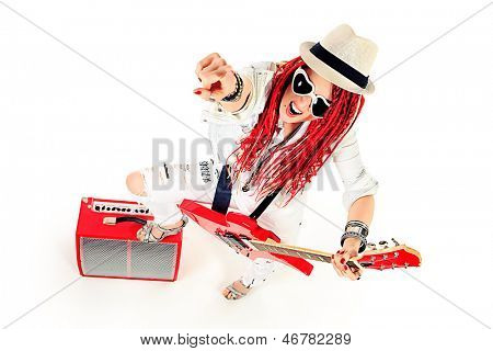 Modern girl rock musician is playing the electric guitar. Isolated over white.