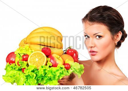 Beautiful young woman holding a plate of fresh fruits. Healthy eating. Isolated over white.