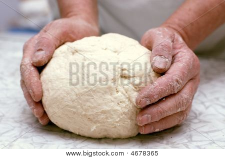 Hands Of Woman Baker Kneading Dough