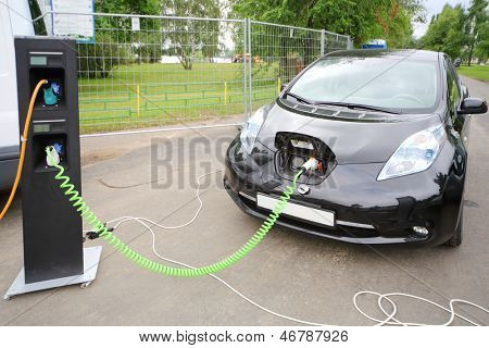MOSCOW - AUGUST 18: Modern electric car recharged at electrical charging at festival Ekofest 2012 on banks of Stroginsky gulf, on August 18, 2012 in Moscow, Russia.