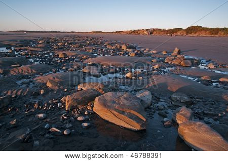 Low tide exposes the rocky bottom