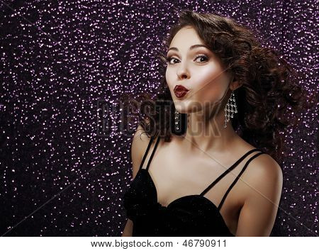 Coquette. Playful Young Woman Blowing A Kiss. Frizzy Hair