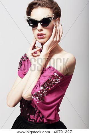High Fashion. Glamorous Elegant Woman In Dark Sunglasses. Magnetism