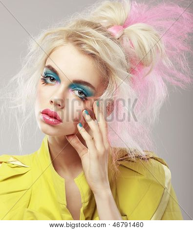 Portrait Of Bright Blonde With Shaggy Hair And Blue Eye Makeup. Glam