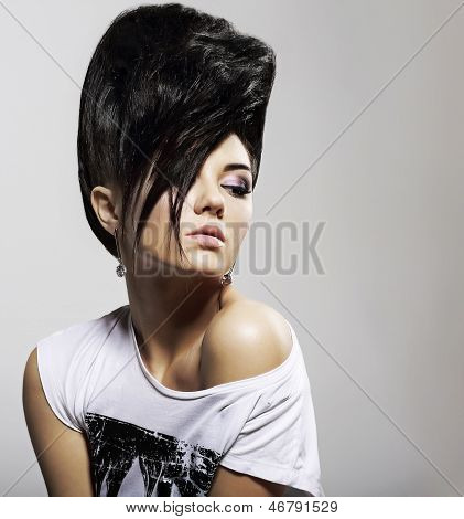 Updo Black Hair. Stylish Woman With Trendy Hairstyle With Diamond Earrings