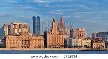 Shanghai historic and urban buildings panorama over Huangpu River in the morning with blue sky.