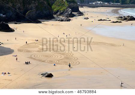 Sand art at Tolcarne Beach, Newquay