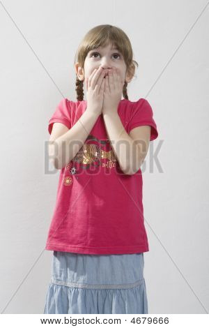 Surprised Little Smiling Girl With Two Plaits Close Her Mouth Her Hands