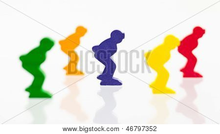 Five Colored Pawns Isolated On A White Background