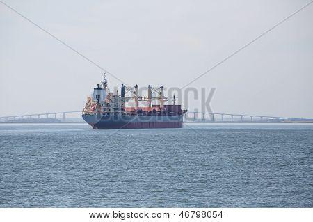 Dredging Ship And Suspension Bridge