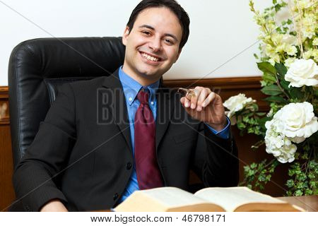 Confident lawyer in his studio