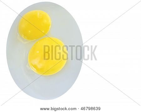 Raw eggs sprawled on the plate oval
