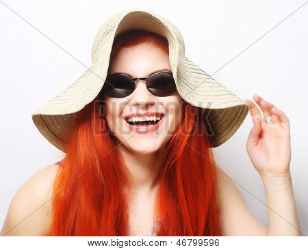 Fashion woman wearing sunglasses and hat. Romantic portrait of summer happy girl. Studio shot.
