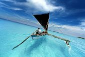 picture of sailing vessels  - rowing boat sailing in a tropical lagoon - JPG