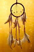 stock photo of dream-catcher  - Beautiful dream catcher on yellow background with lights - JPG