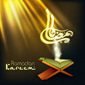 pic of islamic religious holy book  - Arabic Islamic calligraphy of text Ramadan Kareem with open Islamic religious holy book Quran Shareef on shiny abstract background - JPG
