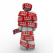 stock photo of stop fighting  - A person or man is oppressed and wrapped up in red tape reading Free Yourself to illustrate the need to fight back and be liberated from the chains that bind you - JPG