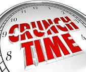 foto of crunch  - The words Crunch Time on a clock to illustrate a rush to beat a deadline - JPG