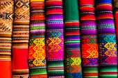 picture of alpaca  - Colorful Fabric at market in Peru South America