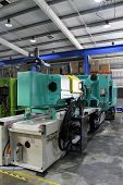 image of thermoplastics  - Injection moulding machine used for the forming of plastic parts using plastic resin and polymers - JPG