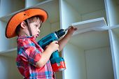 picture of hand drill  - Cute little boy using an electric screwdriver - JPG