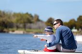 pic of dock a lake  - young father and his son sitting at the marina dock and spending fun time together - JPG