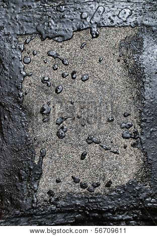 drops of the solidified Black crack tar. The original background of  black.