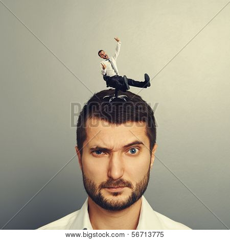 small happy man rolling on the head big dissatisfied man