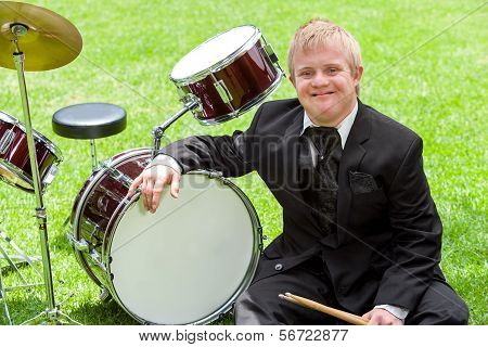 Young Handicapped Drummer Next To Drums.