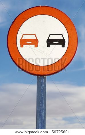 European prohibited overtaking sign on the road ahead