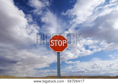 stop signal with cloudy sky