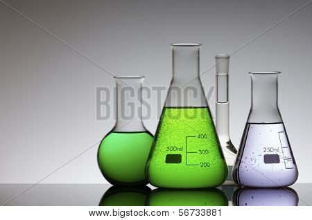 chemical laboratory flasks with colored liquid inside