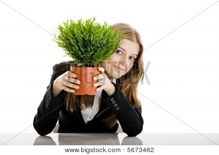 Business Woman Holding A Vase With A Plant